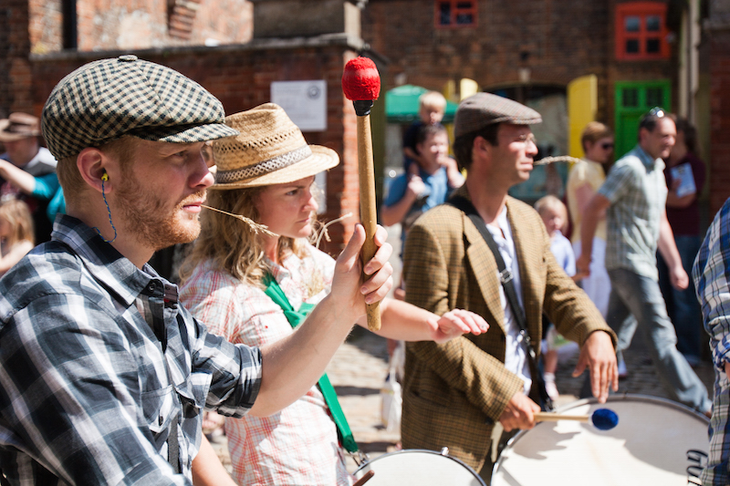 Sol Samba drummers dressed as farmers at Aylesbury Roald Dahl Festival