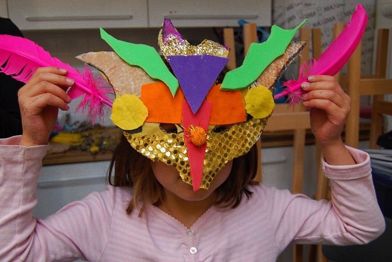 Girl wearing carnival mask